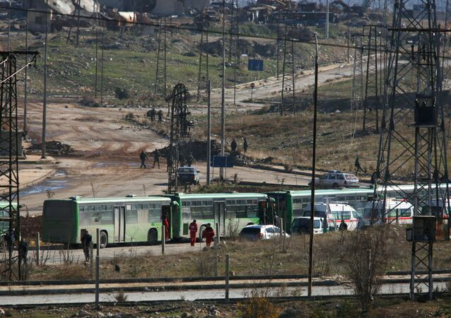 Buses and ambulances wait to evacuate civilians and rebels from eastern Aleppo, Syria December 15, 2016.