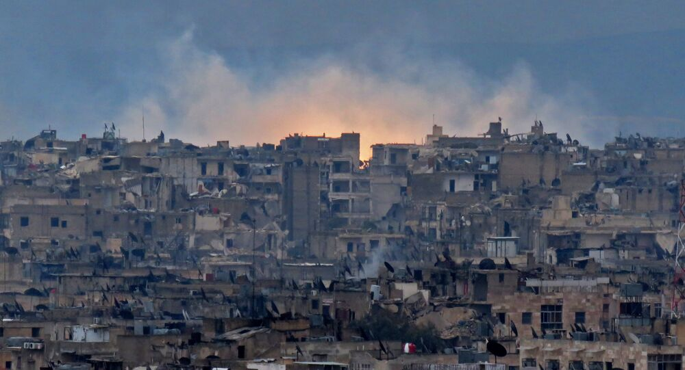 A general view shows smoke and flames rising from buildings in Aleppo's southeastern al-Zabdiya neighbourhood following government strikes on December 14, 2016.