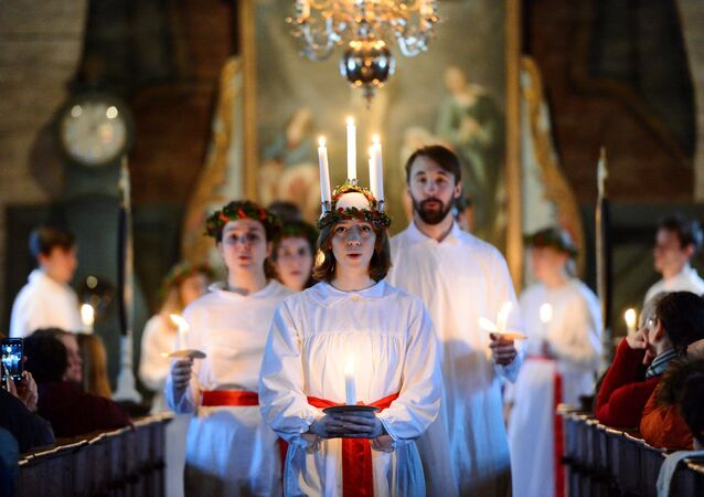 The 'Kongl. Teknologkoren' choir performs in Seglora church at the open-air museum Skansen on Saint Lucy's Day in Stockholm, Sweden, 13 December 2016.