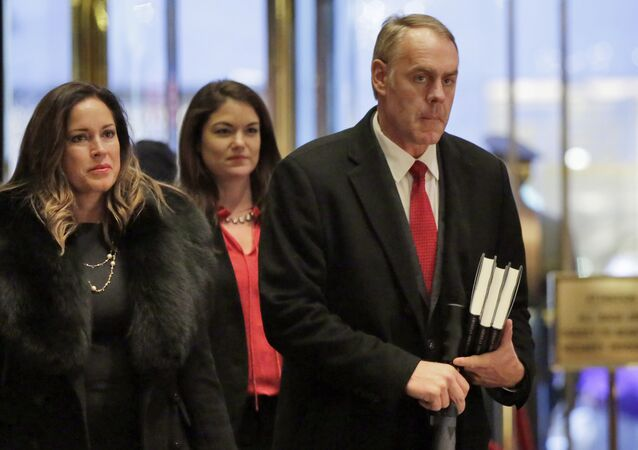 Rep. Ryan Zinke, right, R-Mont., arrives in Trump Tower, in New York