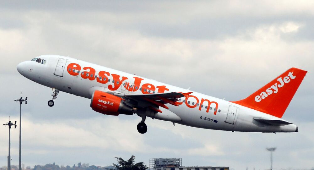 An EasyJet passenger aircraft makes its final approach for landing in Colomiers near Toulouse, Southwestern France, November 24, 2016.