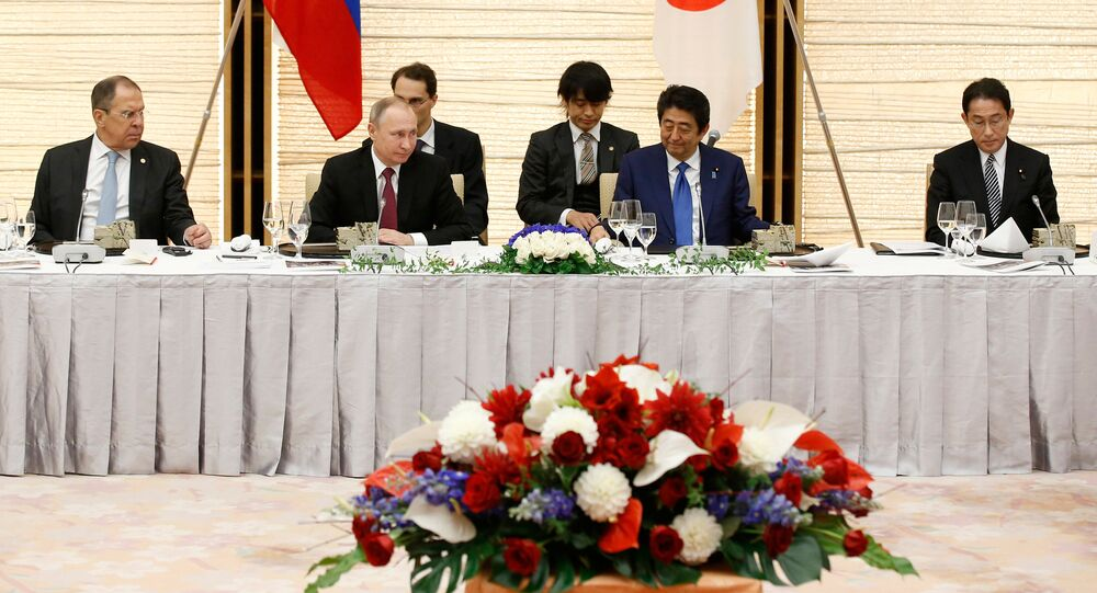 From left to right, Russian Foreign Minister Sergey Lavrov, President Vladimir Putin, Japanese Prime Minister Shinzo Abe and Foreign Minister Fumio Kishida attend a working lunch in Tokyo, Japan, Friday, Dec. 16, 2016.
