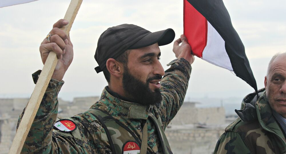 Syrian Arab Army soldier, celebrating liberation of Sheikh Saeed, East Aleppo from Nusra Front led occupation.