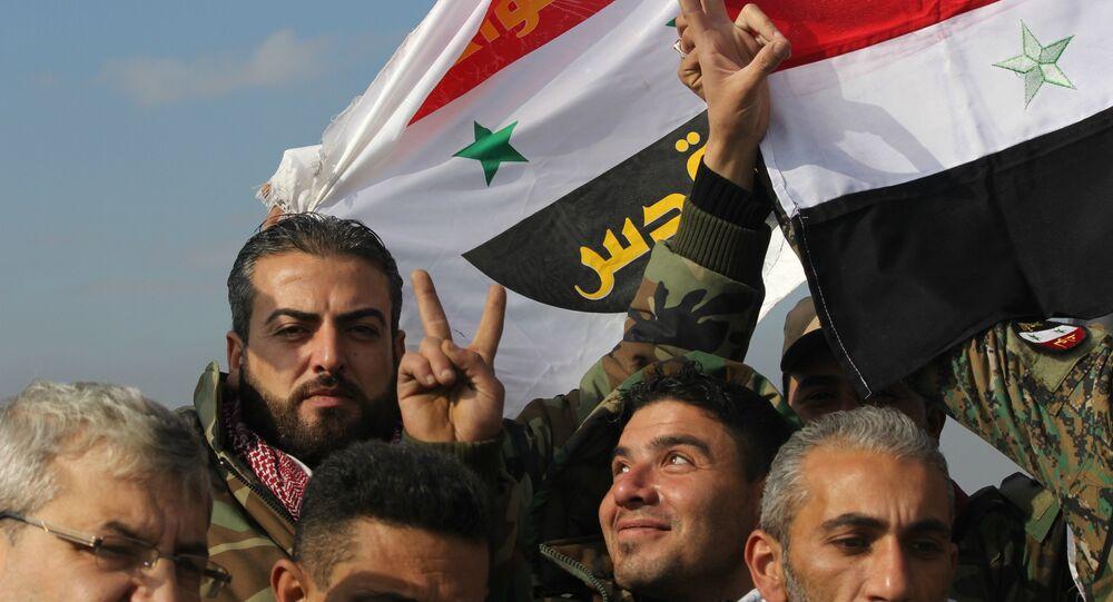 Syrian Arab Army celebrating victory in Sheikh Saeed, East Aleppo.