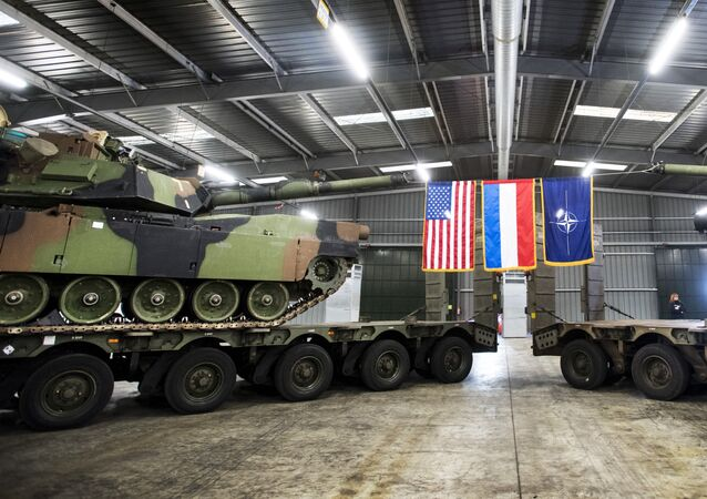 Military armoured vehicles are displayed during the inauguration of the Army Prepositioned Stocks of Eygelshoven (APS-E), a military complex for American equipment in Eygelshoven, on December 15, 2016.