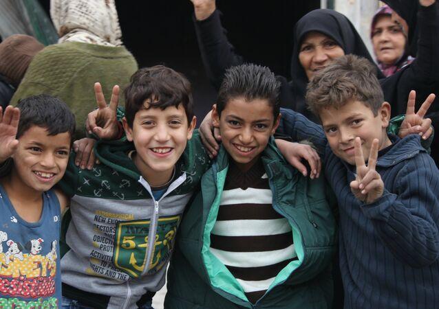 Children celebrating liberation in Hanano, East Aleppo