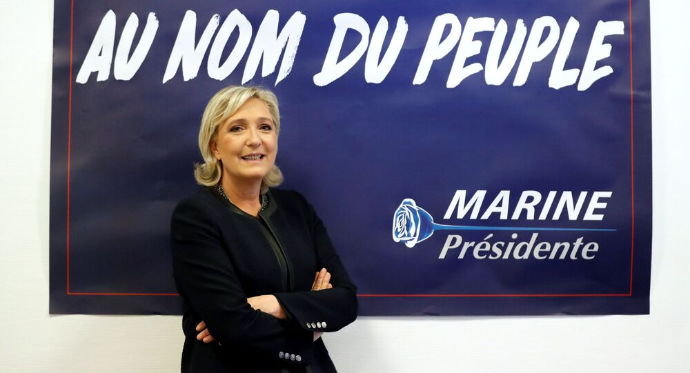 France's far-right National Front (FN) leader Marine Le Pen poses in front of a poster for her 2017 French presidential election campaign as she inaugurates her party campaign headquarters L'Escale in Paris, France, November 16, 2016.