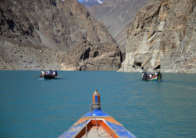 Tourists and locals travel by boat across the Attabad lake in the northern Hunza valley.