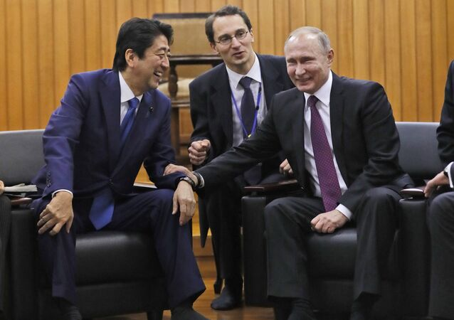 Russian President Vladimir Putin and Japanese Prime Minister Shinzo Abe share a light moment during their visit at Kodokan judo hall in Tokyo, Japan, December 16, 2016.