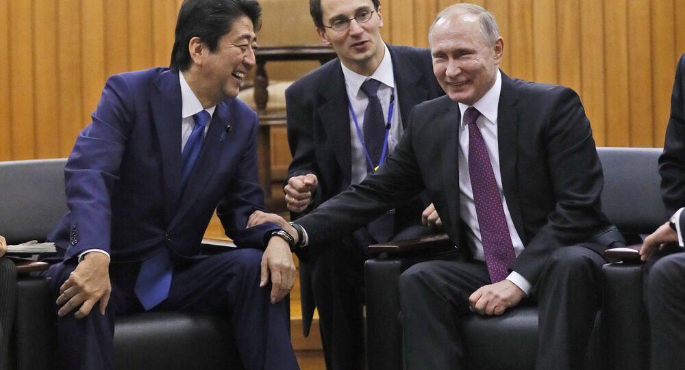 Russian President Vladimir Putin and Japanese Prime Minister Shinzo Abe.