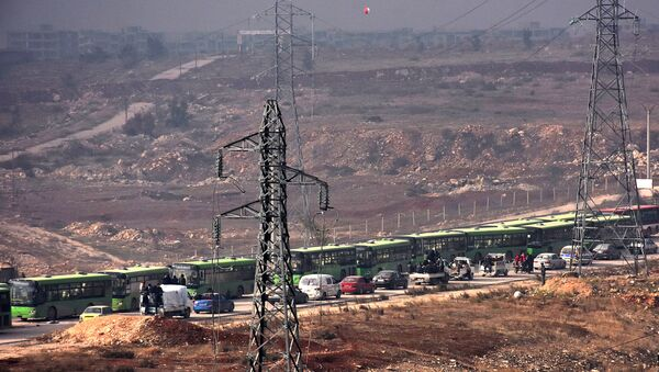 Buses are seen during an evacuation operation of Syrian rebel fighters and civilians from a opposition-held area of Aleppo towards rebel-held territory in the west of Aleppo's province - Sputnik International