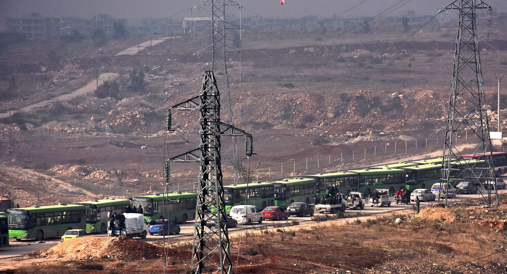 Buses are seen during an evacuation operation of Syrian rebel fighters and civilians from a opposition-held area of Aleppo towards rebel-held territory in the west of Aleppo's province
