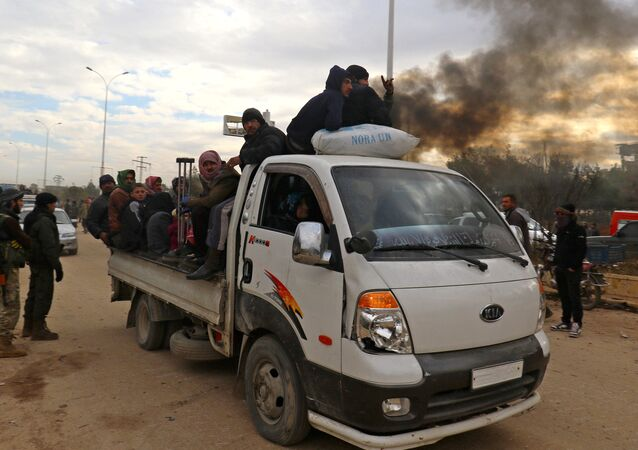 Evacuees from rebel-held eastern Aleppo, arrive to an area on the western edge of Aleppo city which is held by insurgents, Syria December 16, 2016.
