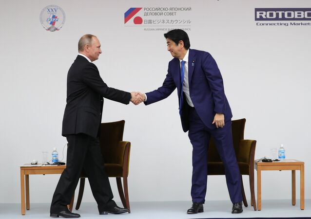 December 16, 2016. Russian President Vladimir Putin and Japanese Prime Minister Shinzo Abe, right, during a joint Russia-Japan business forum in Tokyo.