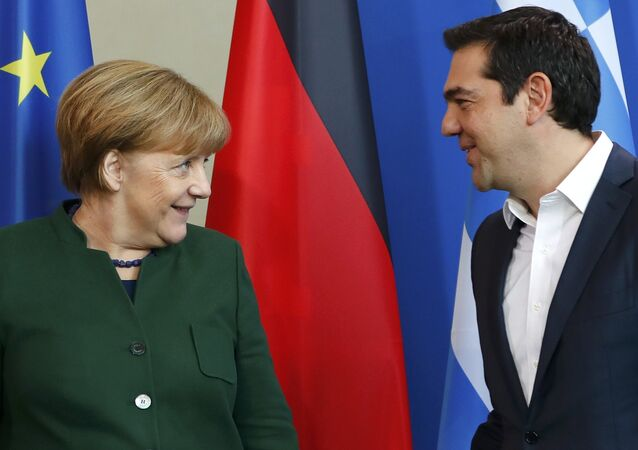 German Chancellor Angela Merkel and Greek Prime Minister Alexis Tsipras (R) leave after a statement at the chancellery in Berlin, Germany, December 16, 2016.