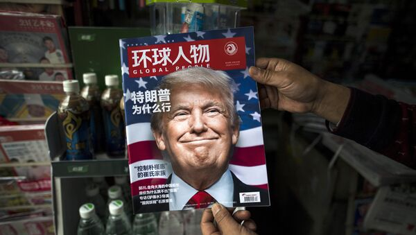 Copy of the local Chinese magazine Global People with a cover story that translates to Why did Trump win at a news stand in Shanghai. (File) - Sputnik International