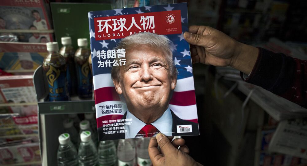 Copy of the local Chinese magazine Global People with a cover story that translates to Why did Trump win at a news stand in Shanghai. (File)