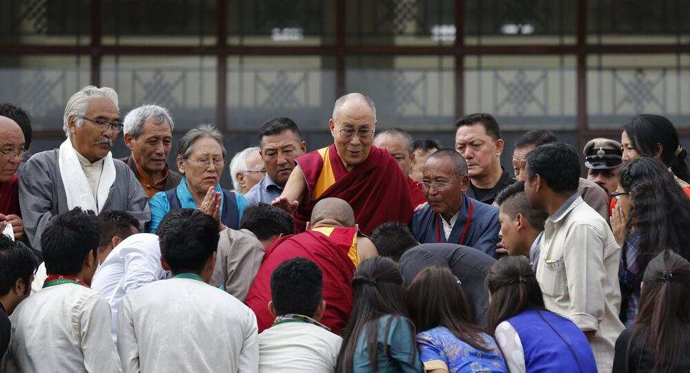 Devotees greet Tibetan spiritual leader, the Dalai Lama, center, during an event to inaugurate the Dalai Lama Institute for Higher Education, on the outskirts of Bangalore, India, Wednesday, Dec.14, 2016.