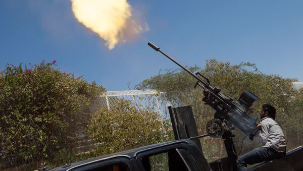 A rebel fighter fires a 23mm anti-aircraft gun from the back of a pick-up truck as a Syrian Airforce plane flies overhead during clashes between the rebels and pro-government troops on the outskirts of the northern city of Aleppo - Sputnik International