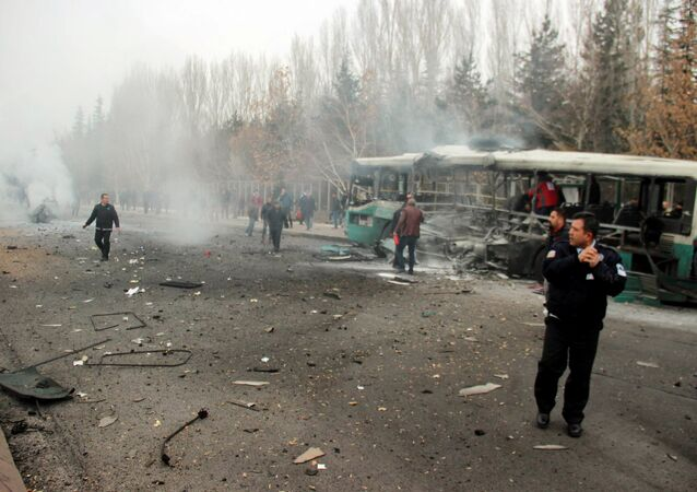 People react after a bus was hit by an explosion in Kayseri, Turkey, December 17, 2016