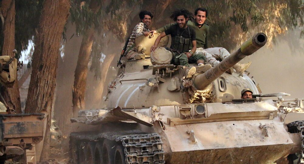 Soldiers from the Libyan National Army, led by Marshal Khalifa Haftar, drive their tank on November 19, 2016 in the Qawarsha sector, 10 kilometres (six miles) west of the centre of Benghazi, after they retook the area from jihadist fighters