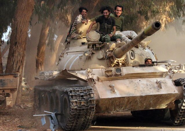 Soldiers from the Libyan National Army, led by Marshal Khalifa Haftar, drive their tank