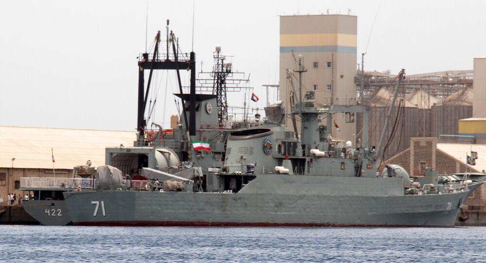 Iranian military ships frigate Alvand (R) and light replenishment ship Bushehr