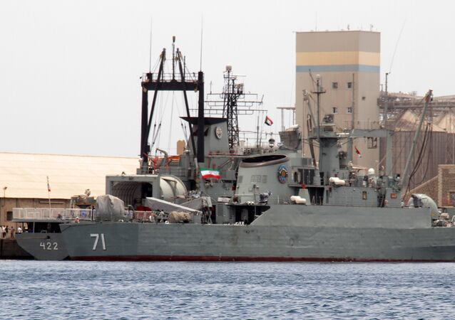 Iranian military ships frigate Alvand (R) and light replenishment ship Bushehr