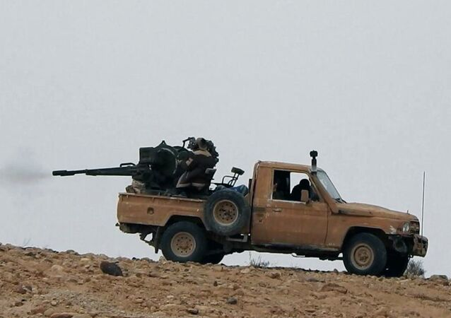 Supporters of the Daesh terror group on an anonymous photo sharing website, purports to show a gun-mounted vehicle operated by the group firing at Syrian troops north of Palmyra city, in Homs, Syria