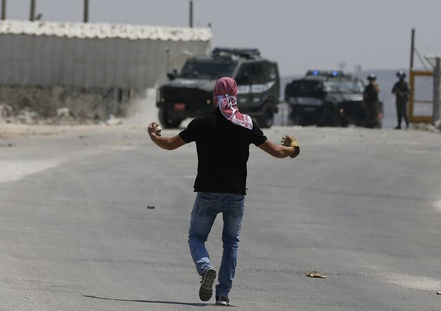 Palestinian students from Birzeit University clash with Israeli security forces outside the Israeli-run Ofer prison in the West Bank village of Betunia on August 3, 2016