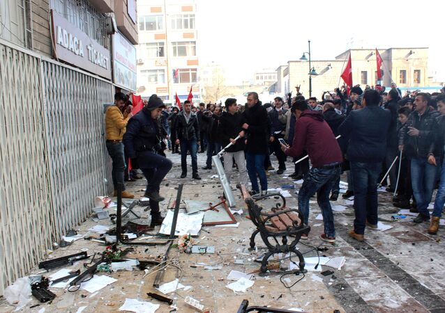 This picture obtained from Dogan News Agency shows people protesting in front of the offices of pro-Kurdish Peoples' Democratic Party (HDP) following a suicide car bombing on December 17, 2016 in Kayseri