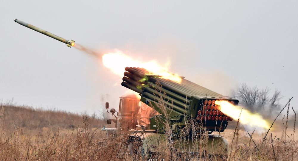 Ukrainian 122 mm MLRS BM-21 Grad fires rocket during a military exercise at a shooting range close to Devichiki in the Kiev region on October 28, 2016