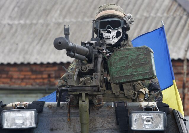 A Ukrainian serviceman wears a mask depicting a skull on September 23, 2014 on armored personnel carrier (APC) in a suburb of the eastern town Debaltseve in the region of Donetsk