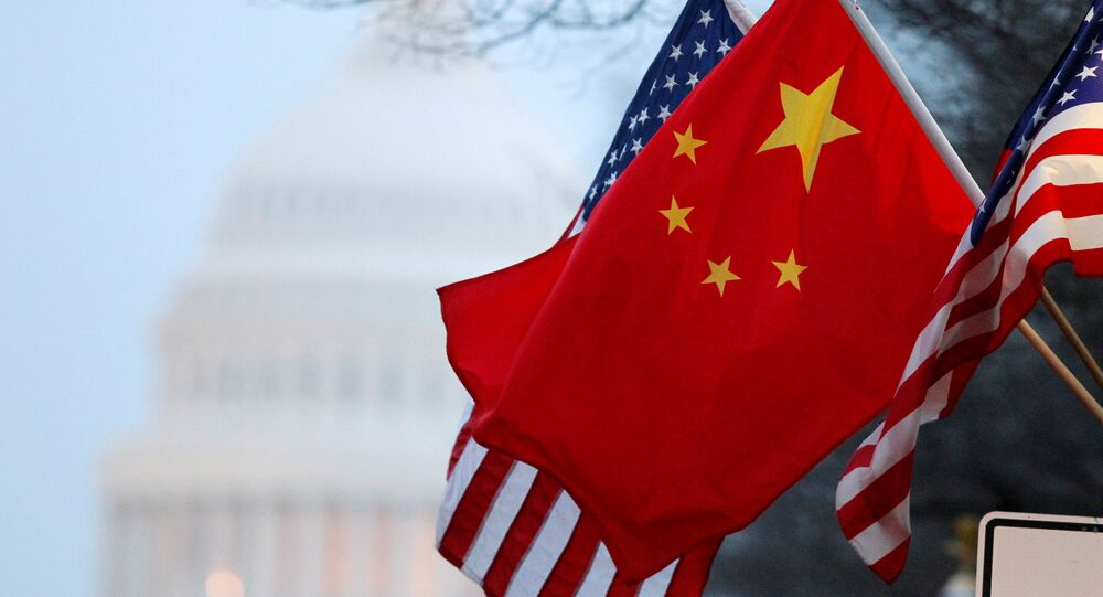 The People's Republic of China flag and the U.S. Stars and Stripes fly along Pennsylvania Avenue near the US Capitol