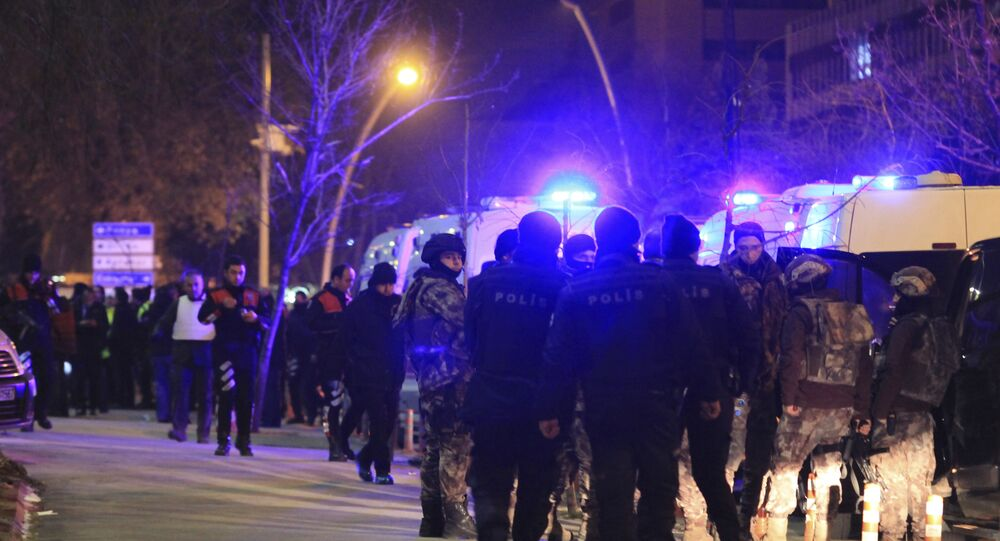 Turkish police officers secure the area close to a photo gallery where the Russian Ambassador to Turkey, Andrei Karlov, was shot by a gunman in Ankara, Turkey.