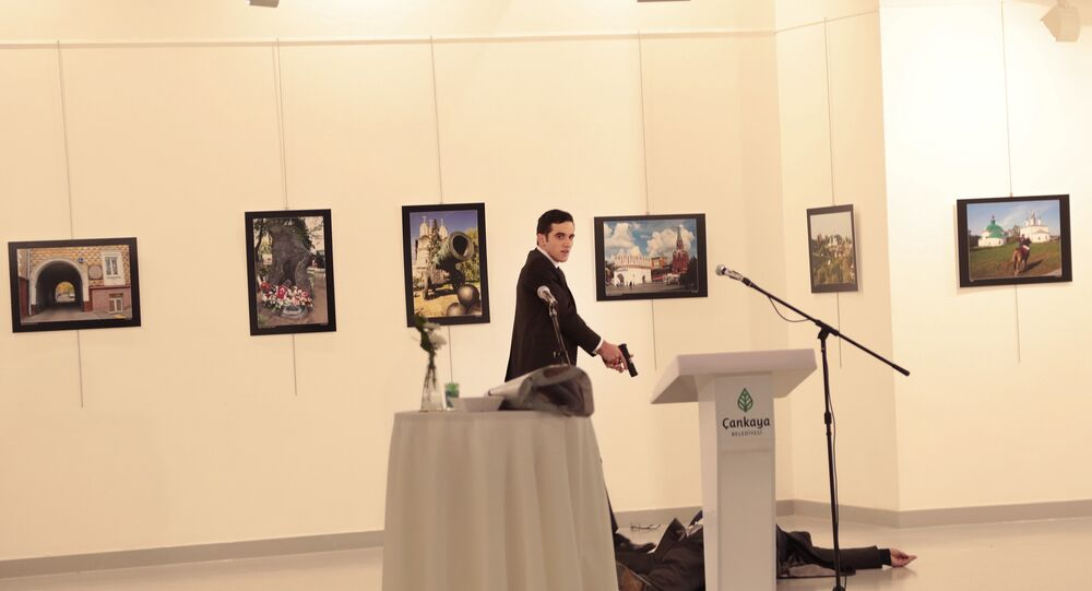 An unnamed gunman gestures after shooting the Russian Ambassador to Turkey, Andrei Karlov, at a photo gallery in Ankara, Turkey.