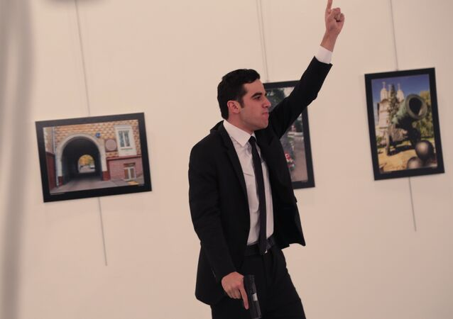 An unnamed gunman gestures after shooting the Russian Ambassador to Turkey, Andrei Karlov, at a photo gallery in Ankara.