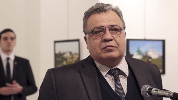 Andrei Karlov, the Russian Ambassador to Turkey, speaks at a photo exhibition in Ankara on Monday, Dec. 19, 2016, moments before a gunman opened fire on him - Sputnik International
