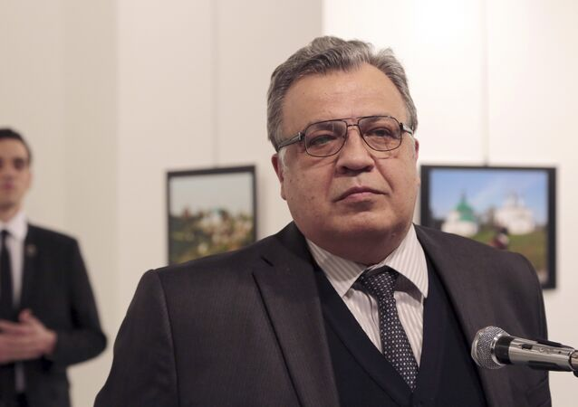 Andrei Karlov, the Russian Ambassador to Turkey, speaks at a photo exhibition in Ankara on Monday, Dec. 19, 2016, moments before a gunman opened fire on him