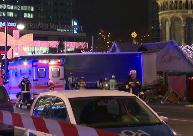 Emergency services attend the scene, after an attack by a truck at a Christmas market, in Berlin.