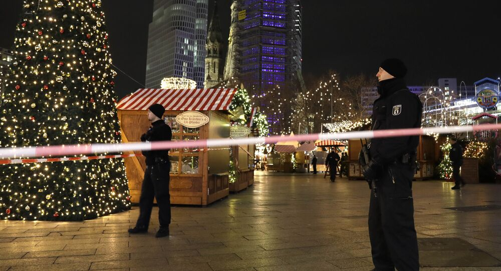 Police guard a Christmas market after a truck ran into the crowded Christmas market in Berlin, Germany.