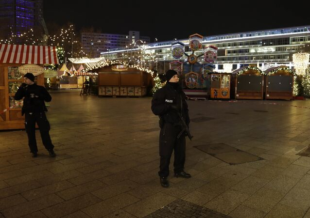 Police guard a Christmas market after a truck ran into the crowded Berlin Christmas market.
