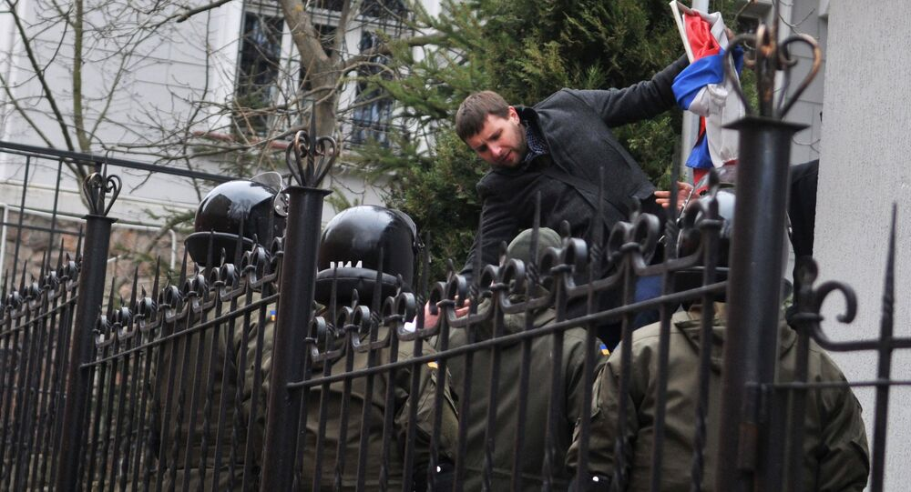 Independent MP of Ukraine's Supreme Rada Vladimir Parasyuk ripping off the Russian flag from the building of the Russian Consulate General in Lviv during a rally