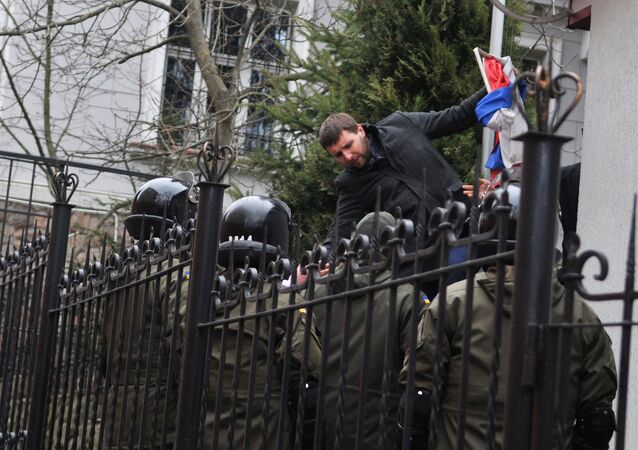 Independent MP of Ukraine's Supreme Rada Vladimir Parasyuk ripping off the Russian flag from the building of the Russian Consulate General in Lviv during a rally demanding liberation of Nadezhda Savchenko. File photo