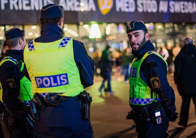 Police officers are pictured ahead of the Euro 2016 play-off football match between Sweden and Denmark at the Friends arena in Solna on November 14, 2015
