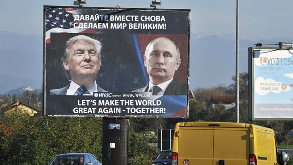 Cars pass by a billboard showing US President-elect Donald Trump and Russian President Vladimir Putin placed by pro-Serbian movement in the town of Danilovgrad on November 16, 2016 - Sputnik International