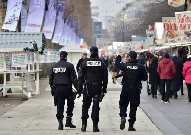 French police officers secure a Christmas market on the Champs Elysees avenue in Paris on December 20, 2016 as part of security measures in the aftermath of an attack in Berlin