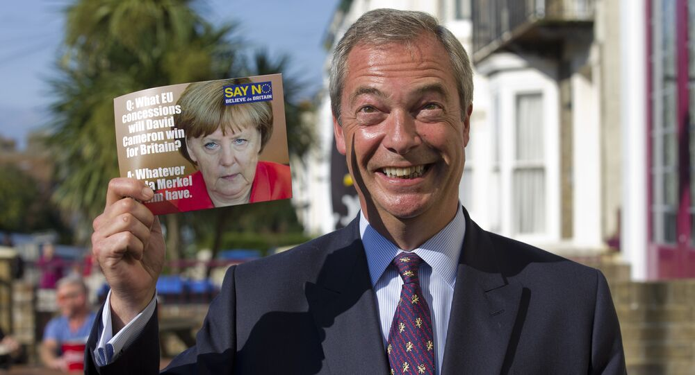 Leader of the UK Independence Party (UKIP) Nigel Farage, poses with a leaflet showing a picture of German Chancellor Angela Merkel in Cliftonville, Margate east of London, as he kicks off their Say No To The EU tour on September 7, 2015, during the party's referendum campaign.