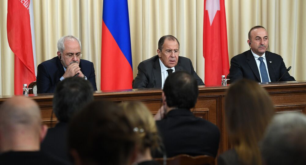 Iranian Foreign Minister Mohammad Javad Zarif, Russian Foreign Minister Sergei Lavrov and Turkish Foreign Minister Mevlut Cavusoglu attend a press conference in Moscow on December 20, 2016