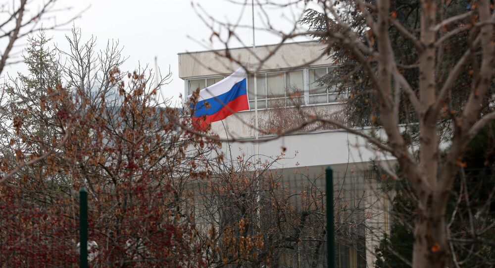 Russian flag flies at half mast in front of the Russian Embassy in Ankara on December 20, 2016, a day after the Russian Ambassador to Turkey was killed by a gunman